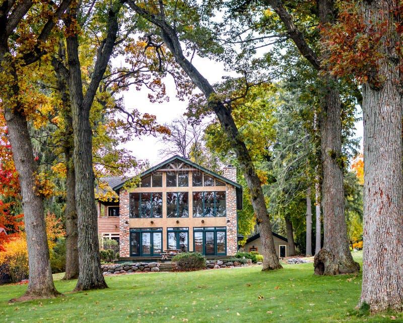 House with Fall Trees, Lake Geneva Shorepath royalty free stock photos