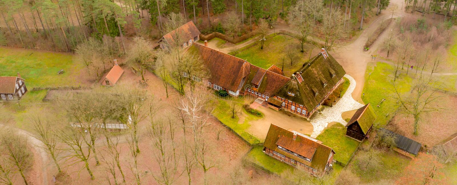 Large house and stables in the Hösseringen open-air museum in the Lünebürger Heide near Suderburg from the air, with historic. Farms and houses in the stock photo