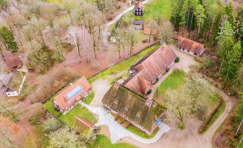 Large house and stables in the Hösseringen open-air museum in the Lünebürger Heide near Suderburg from the air, with historic. Farms and houses in the stock image