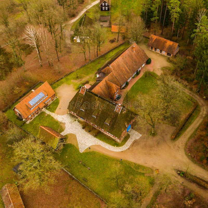 Large house and stables in the Hösseringen open-air museum in the Lünebürger Heide near Suderburg from the air, with historic. Suderburg, Germany stock photos