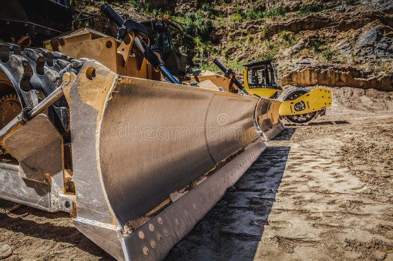 Large industrial bulldozers. Large industrial bulldozers on construction site stock image