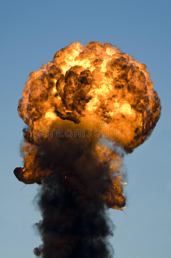 Large industrial fire with thick black smoke stock image
