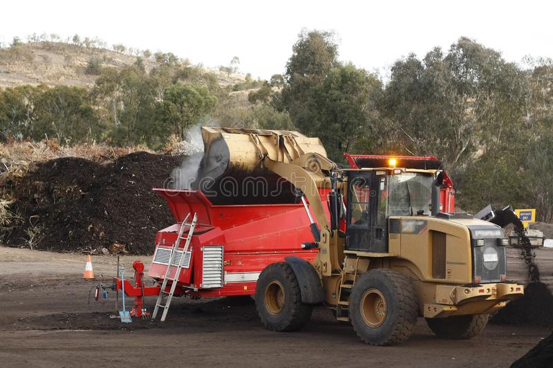 Large industrial machinery being used at a garbage dump stock photos
