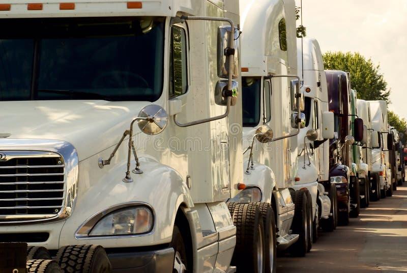Large Industrial Trucks In Traffic Jam Royalty Free Stock Photos