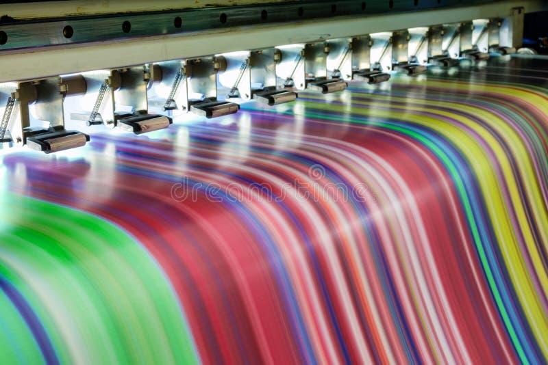 Large Inkjet printer working multicolor on vinyl banner stock photography