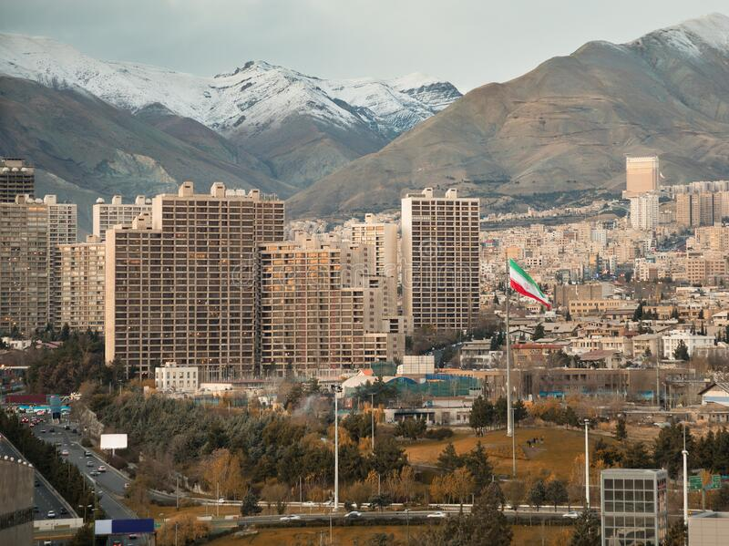 Large Iran Flag and Tehran City Skyline against Alborz Mountains with Instagram Warm Effect stock images