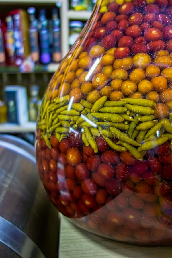 Large jar of peppers of several types in municipal popular market in Brazil.  royalty free stock photo