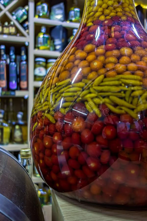 Large jar of peppers of several types in municipal popular market in Brazil.  stock photo