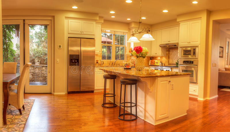 Large kitchen with recessed lighting, wood floors. Irvine, CA, USA – August 19, 2016: Large kitchen with recessed lighting, wood floors, chrome stove stock photo