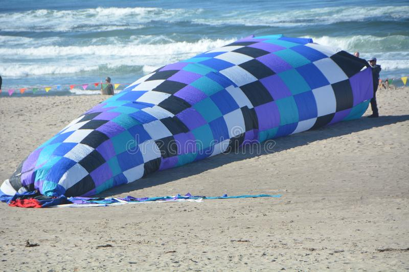 A large kite inflates with air on the Oregon coast at Lincoln City. The Lincoln City Kite Festival takes place twice a year, in summer June and fall October, at stock photography
