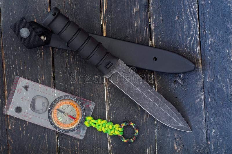 A large knife with a fixed blade with compass. Military bayonet-knife. Top view. A large knife with a fixed blade with compass. Military bayonet-knife royalty free stock image