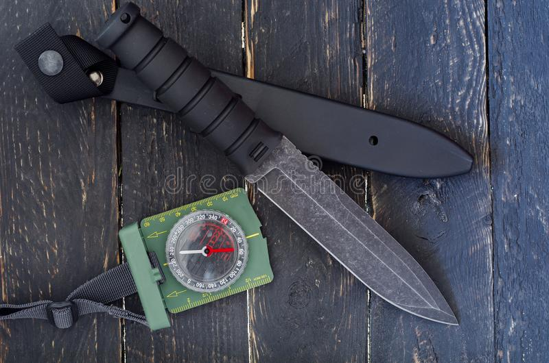A large knife with a fixed blade. Military bayonet-knife. Black background royalty free stock image