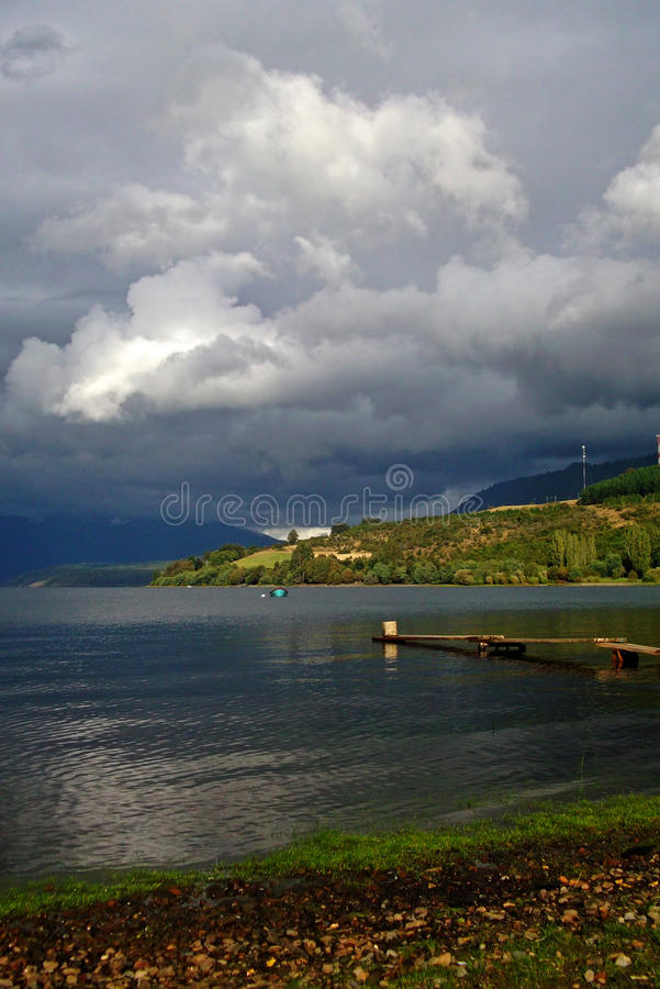Large lake landscape and rainbow in Chile royalty free stock photos