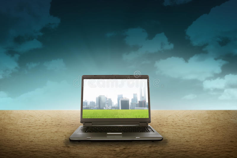 Large laptop on the desert royalty free stock images