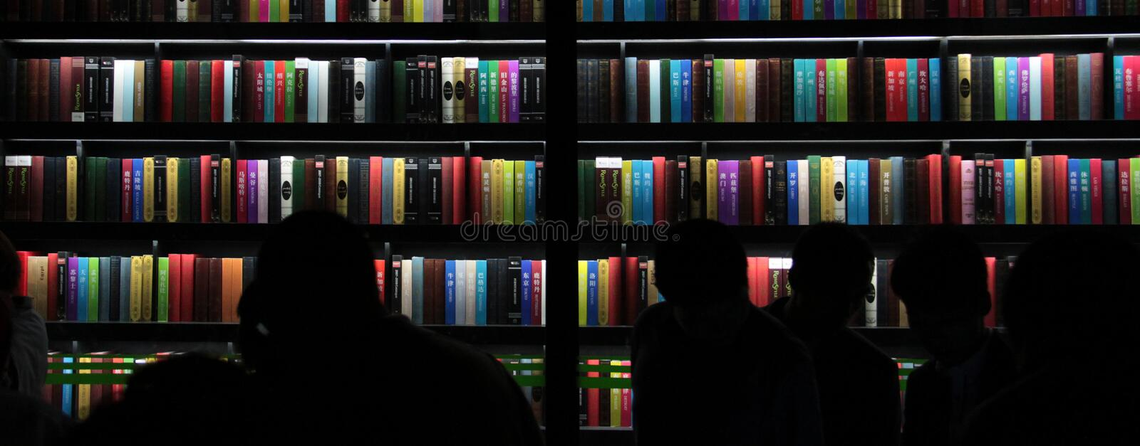 Large light bookstack people watch it royalty free stock photography