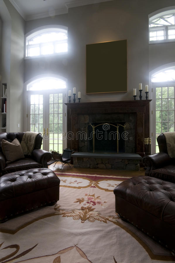 Large living room leather chairs fireplace stock photography