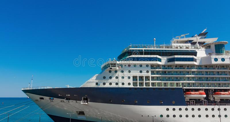 A large luxury cruise liner moored in the port of the Adriatic Sea, is waiting for passengers. There are four orange lifeboats. A large cruise liner moored in royalty free stock photo