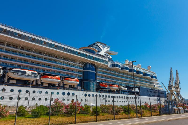 A large luxury cruise liner moored in the port of the Adriatic Sea, is waiting for passengers. There are orange lifeboats abroad. Of a cruise ship. Near harbor royalty free stock image