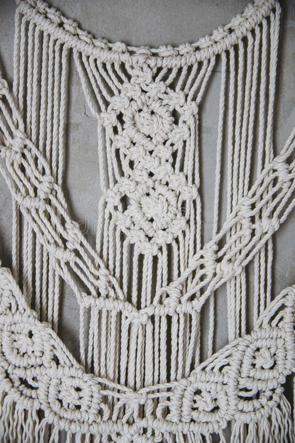 Large Macrame Wall Hanging. Wall panel in the style of Boho made of cotton threads in natural color using the macrame technique for home decor and wedding royalty free stock photography
