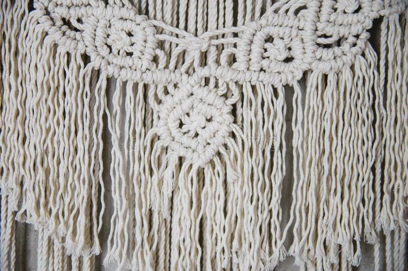 Large Macrame Wall Hanging. Wall panel in the style of Boho made of cotton threads in natural color using the macrame technique for home decor and wedding royalty free stock images