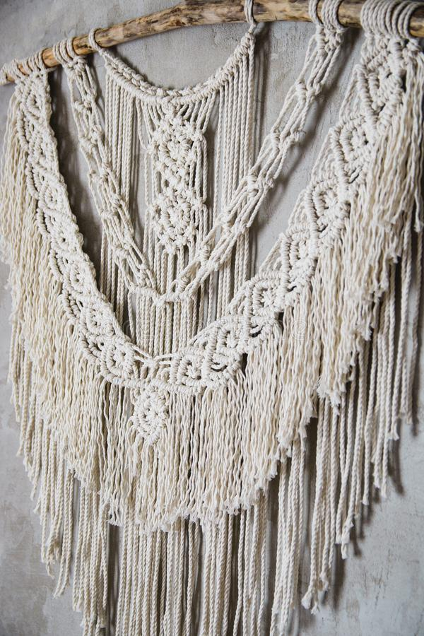 Large Macrame Wall Hanging. Wall panel in the style of Boho made of cotton threads in natural color using the macrame technique for home decor and wedding royalty free stock photos