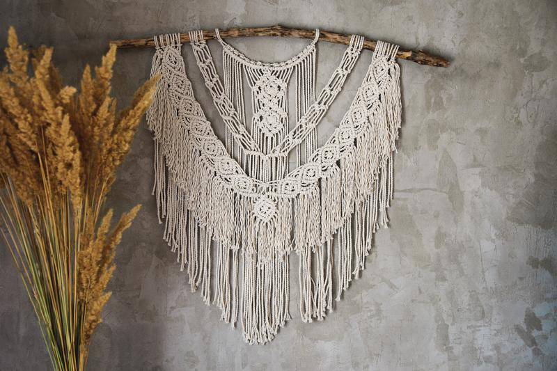 Large Macrame Wall Hanging. Wall panel in the style of Boho made of cotton threads in natural color using the macrame technique for home decor and wedding stock images