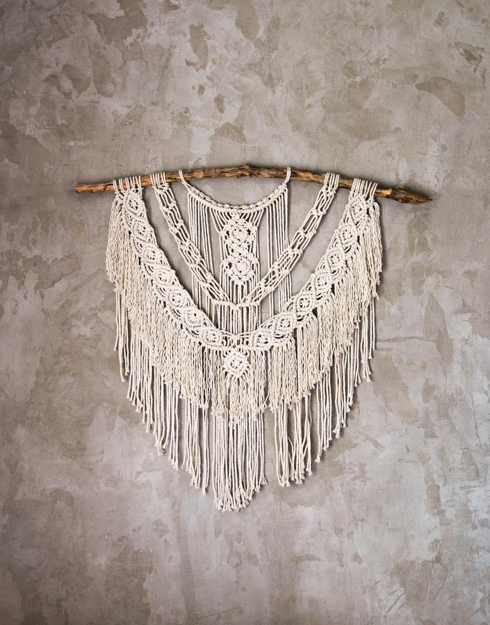 Large Macrame Wall Hanging. Wall panel in the style of Boho made of cotton threads in natural color using the macrame technique for home decor and wedding stock photos