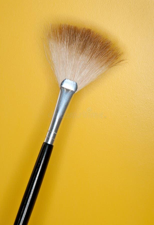 Large Make-up Brushes. Fan Blush brush on Yellow royalty free stock images