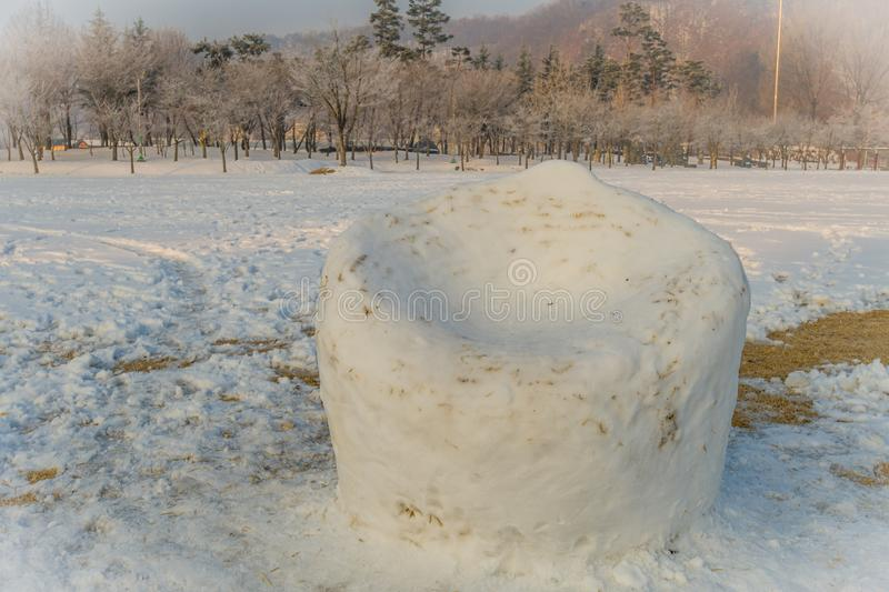 Large man made snow chair royalty free stock images