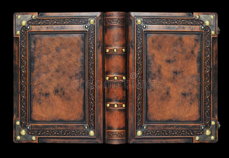 Large medieval book cover with the tree of life, leather bound with brass corners over the black background royalty free stock images