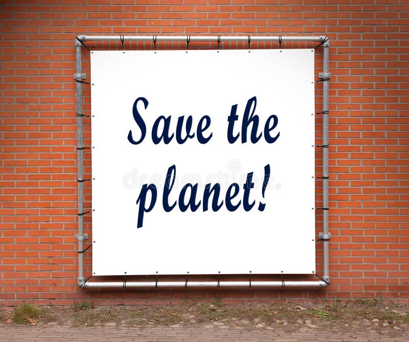 Large message written on a wall - Save the planet. Large message written on white plastic, on a wall - Save the planet royalty free stock photos