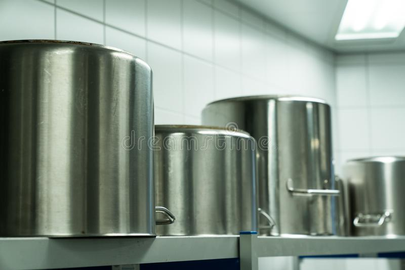 Large metal cooking pots in an industrial kitchen royalty free stock photos