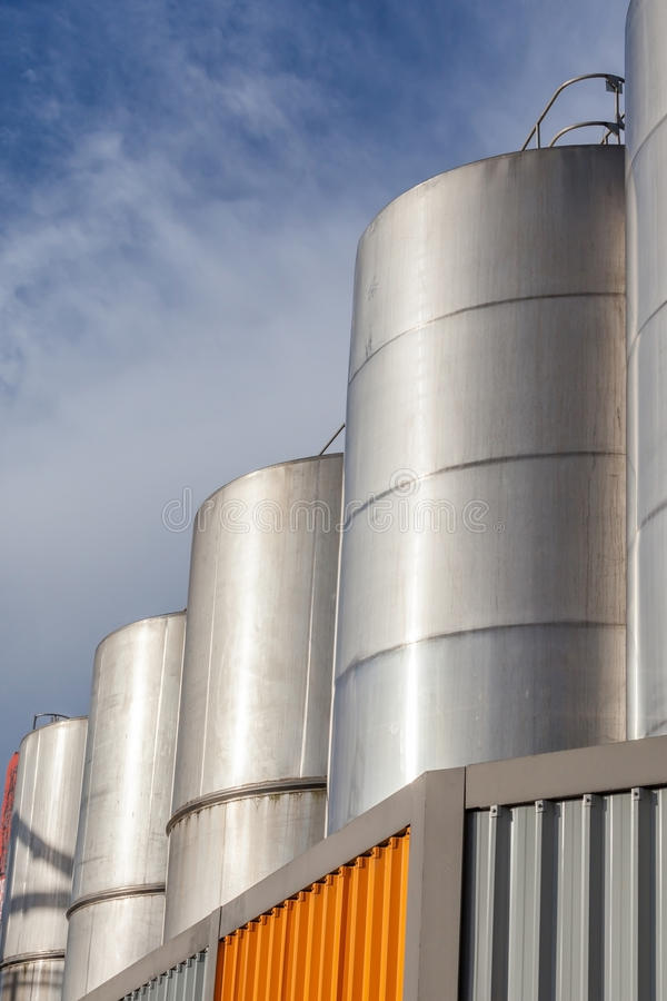 Large metal industrial tanks for petrol and oil storage in refin. Ery industry stock image