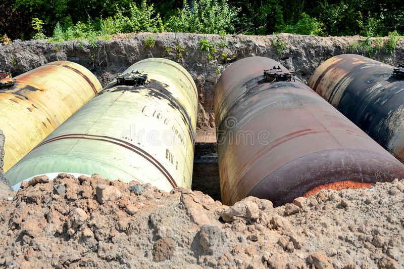 Large metal tanks are buried in the ground in the production warehouse stock photography