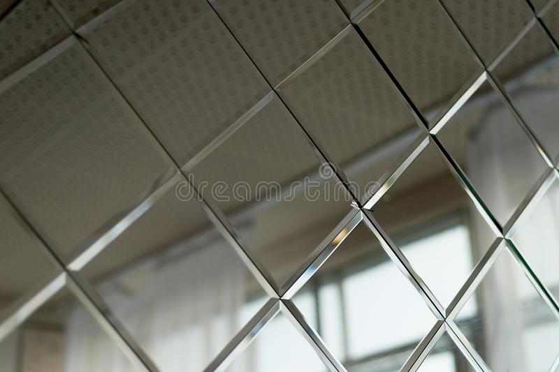 Large mirror tiles, used for wall decor in the bathroom.Room design and finishing. Large mirror tiles, used for wall decor in the bathroom. Room design and royalty free stock photo