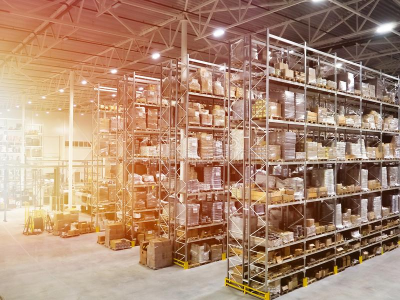 Large modern blurred warehouse industrial and logistics companies. Warehousing on the floor and called the high shelves stock image
