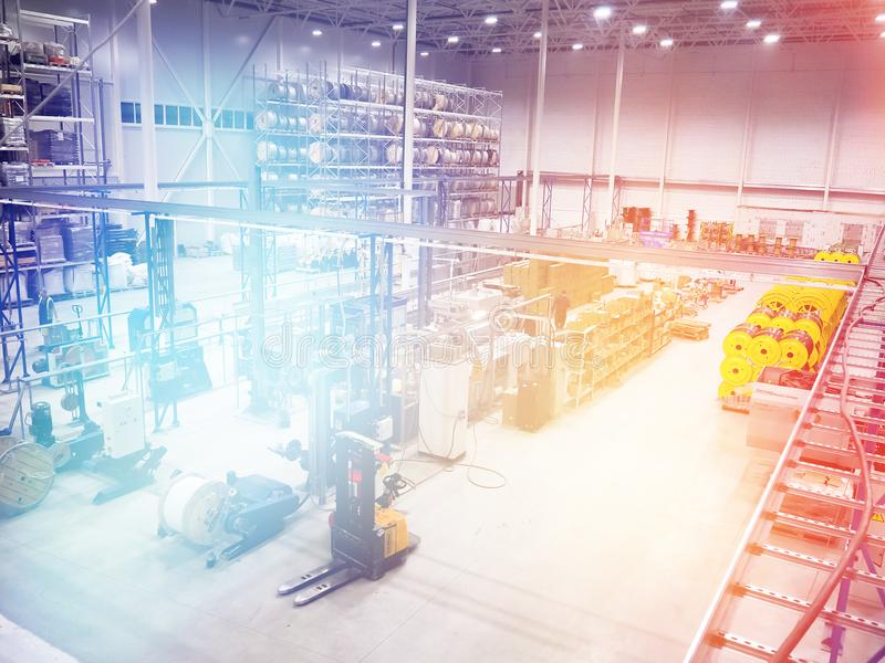 Large modern blurred warehouse industrial and logistics companies. Warehousing on the floor and called the high shelves stock photo