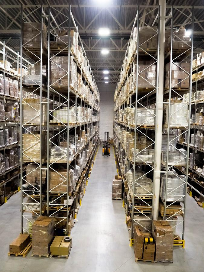 Large modern blurred warehouse industrial and logistics companies. Warehousing on the floor and called the high shelves.  royalty free stock photo