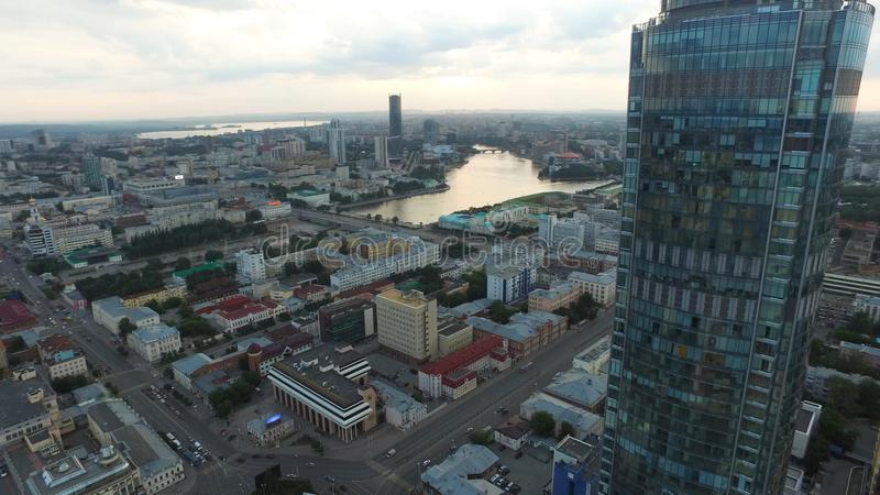 Large modern city center viewed from above. Beautiful of Yekaterinburg aerial view city with river, Russia stock photography