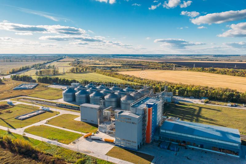 Large modern silos granary steel tanks or containers for silos, wheat and other cereals. Industrial agriculture, aerial view stock images