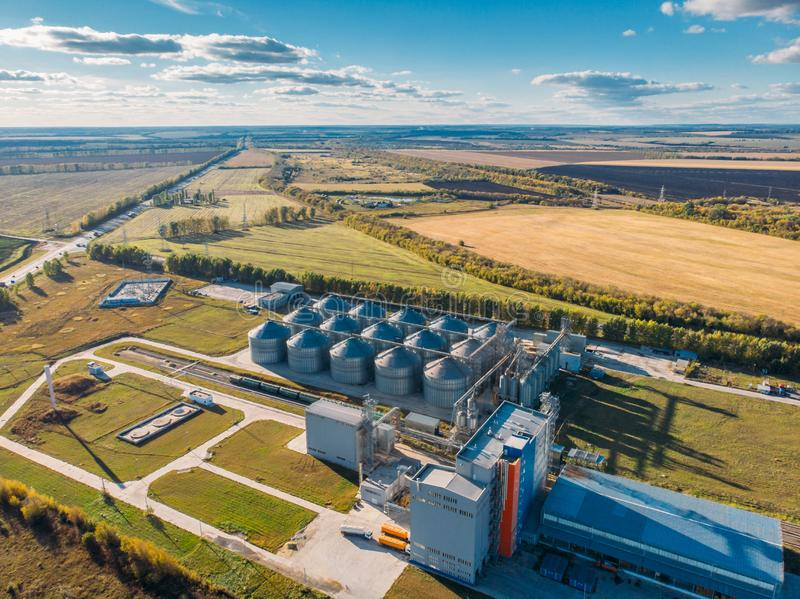 Large modern silos granary steel tanks or containers for silos, wheat and other cereals. Industrial agriculture, aerial view royalty free stock images