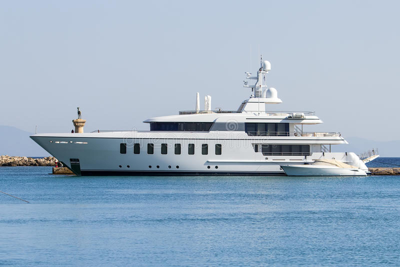 The large modern white private yacht alongside the dock. royalty free stock photos