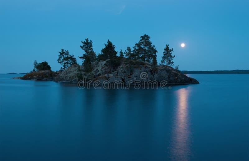 Large Moon over small island. Light nights. Ladoga Lake stock images