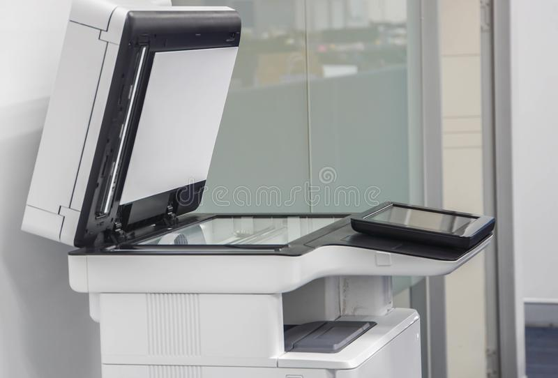 Large multi functional printer standing in office for use in copying, scanning stock photos
