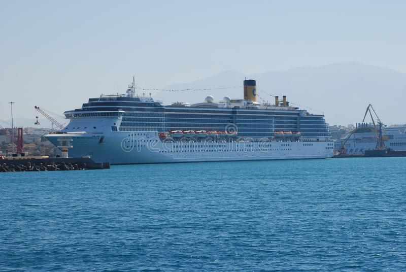 Large multideck cruise liner in the port of Heraklion on the island of Crete. Ship, luxury, vacation, white, sea, boat, tourism, travel, ocean, vessel, water stock photo