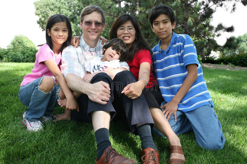 Download Large Multiracial Family Sitting On Lawn Stock Photo - Image: 6120568