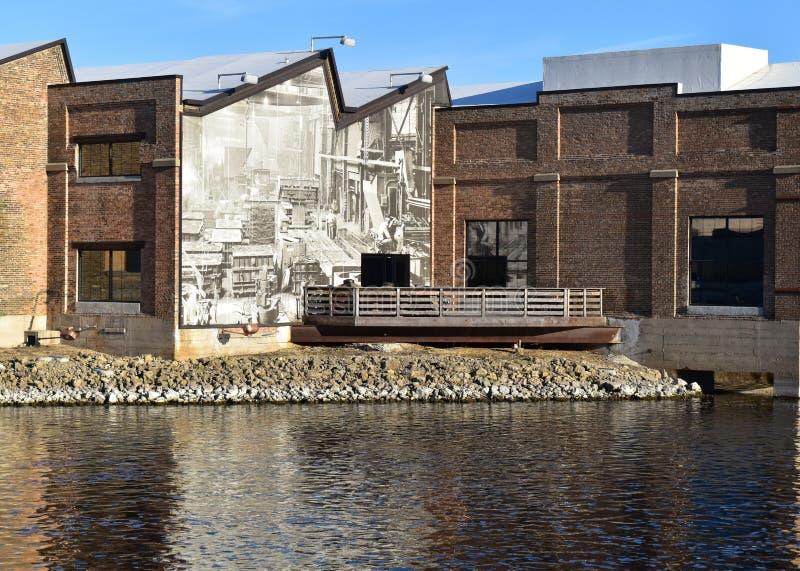 Public art on refurbished warehouse stock image