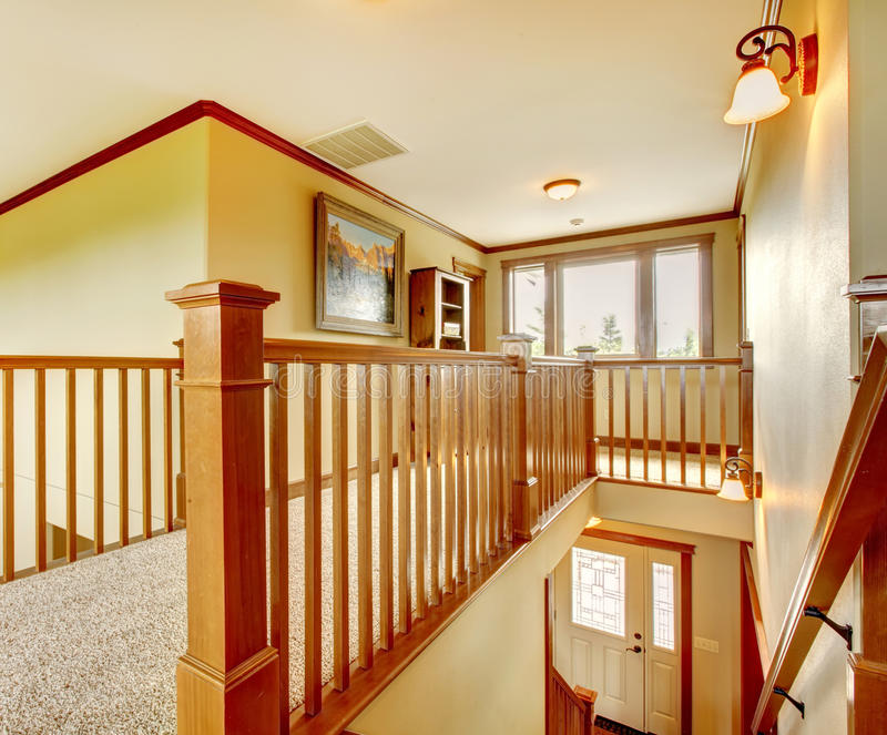 Large new American Home staircase hallway details. Large new American Home staircase hallway details with wood railing stock image
