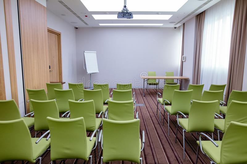 Large new meeting room with rows of modern green chairs royalty free stock photos