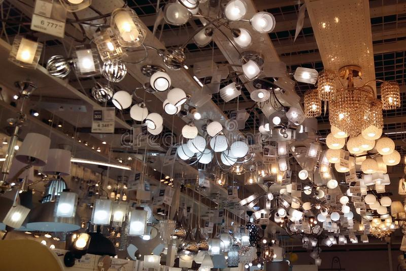 A large number of ceiling lamps, chandeliers in the store. royalty free stock images